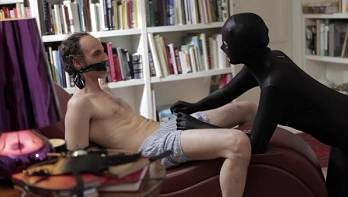 Feminine domination over bound guy in morph costume