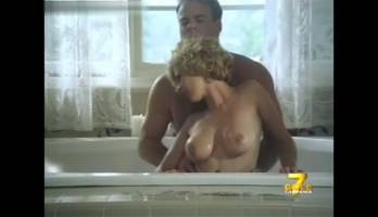 Sex in bathroom with busty blonde MILF