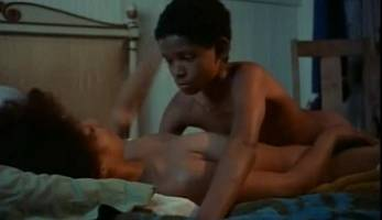 Black woman having sex with a young